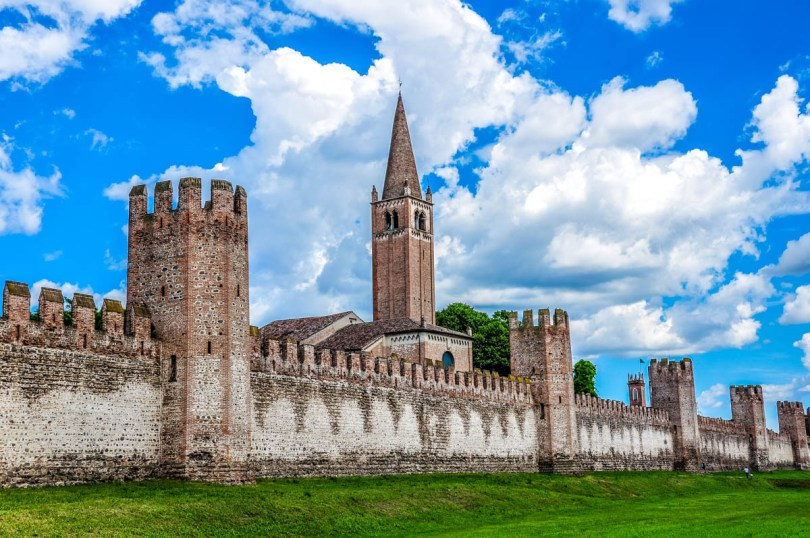 The medieval defensive wall with the Church of San Francesco and the grassy moat - Montagnana, Veneto, Italy - rossiwrites.com