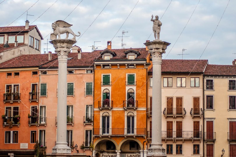 The pillars at Piazza dei Signori with Christmas lights - Vicenza, Italy - rossiwrites.com