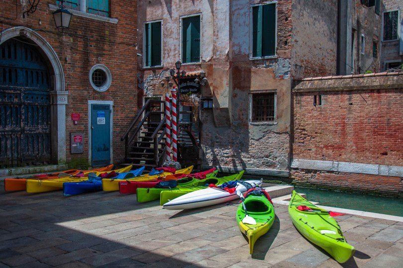 Colourful canoes at Rialto Fish Market - Venice, Italy - rossiwrites.com