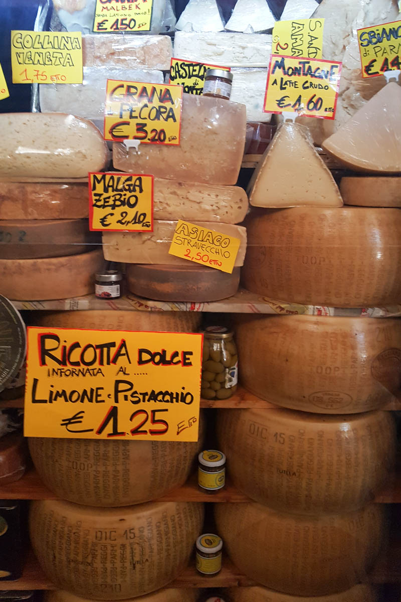 A cheese selection gracing a deli window - Padua, Veneto, Italy - rossiwrites.com