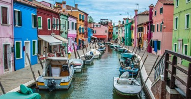 Colourful houses and boats alongside a canal - Burano, Veneto, Italy - rossiwrites.com
