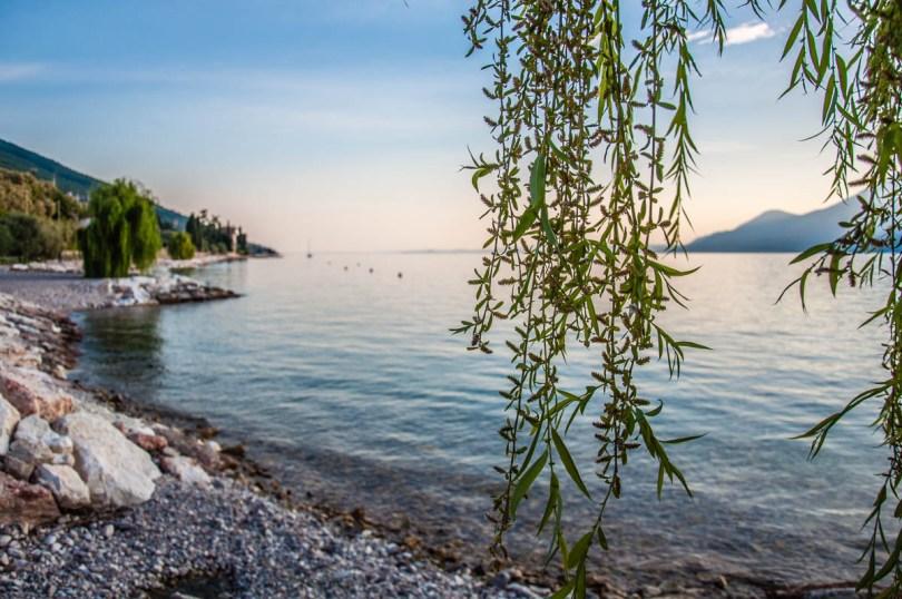 The lake seen with the promenade and the beach of Castelleto sul Garda - Lake Garda, Veneto, Italy - rossiwrites.com