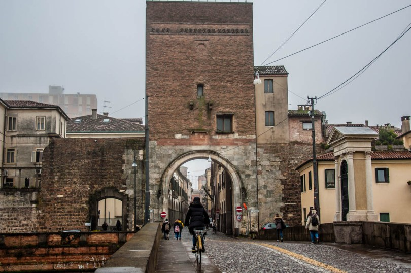 The Roman bridge Ponte Molino with the medieval gate Porta Molino - Padua, Veneto, Italy - rossiwrites.com
