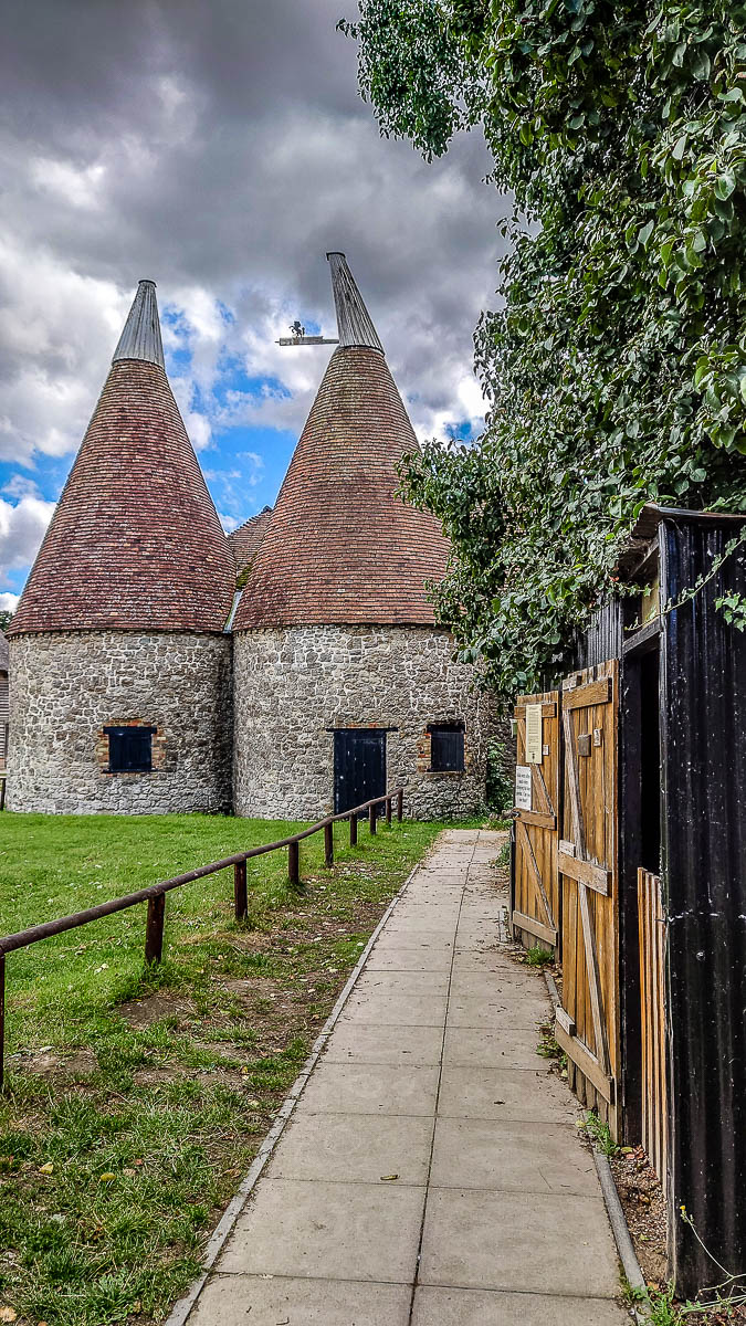 The oast house with the hoppers' huts - Kent Life - Maidstone, Kent, England - rossiwrites.com