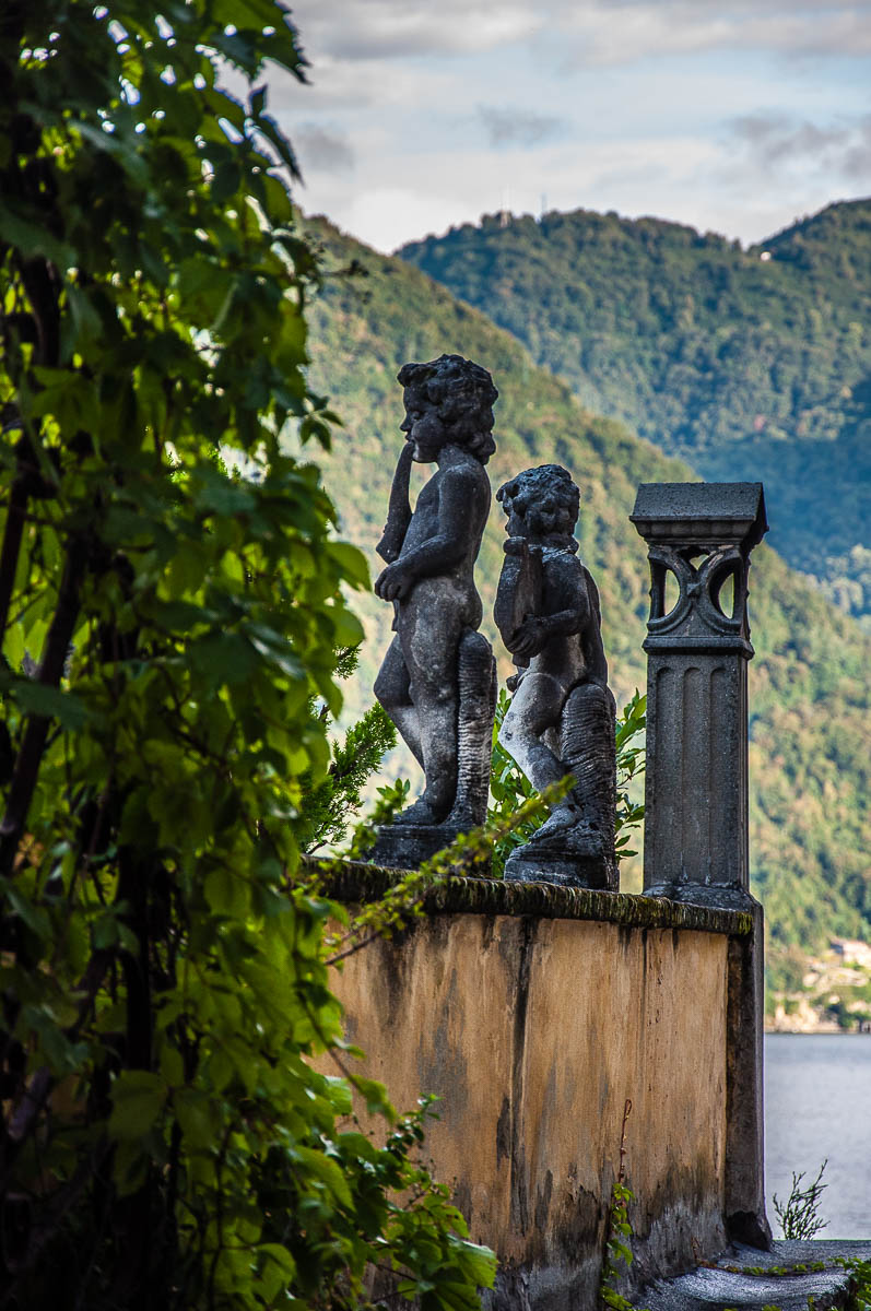 Statues adorning the terrace of a house in Nesso - Lake Como, Italy - rossiwrites.com