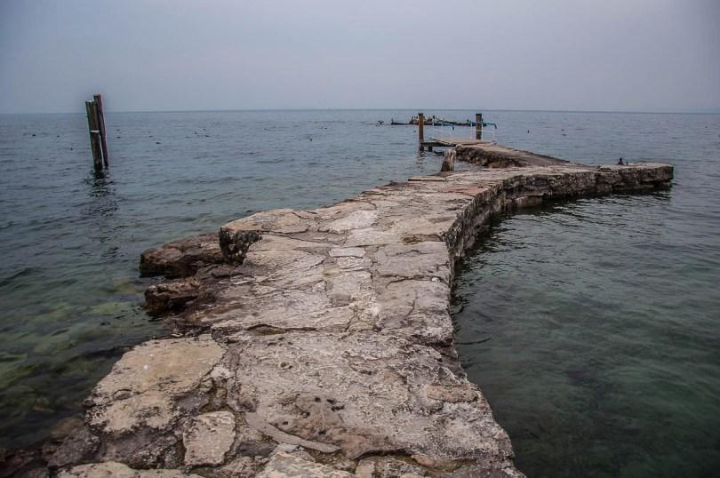 The stone jetty of the small harbour - Punta di San Vigilio - Lake Garda, Italy - rossiwrites.com