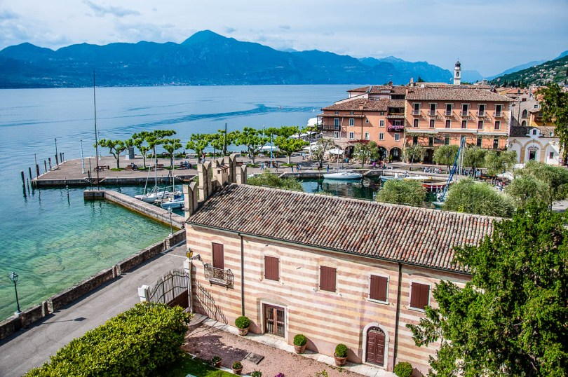 The view from the Scaliger Castle's towers with the historic harbour - Torri del Benaco, Italy - rossiwrites.com
