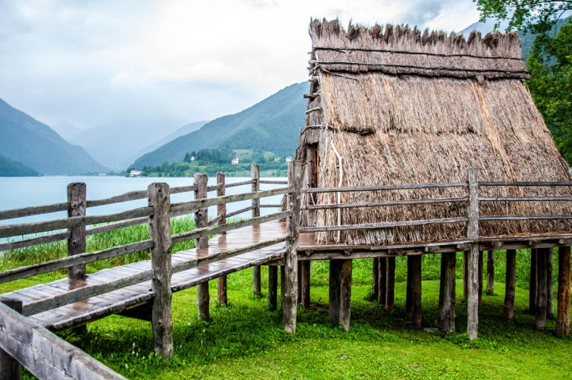 Lake Ledro with the recreated prehistoric stilt house - Trentino, Italy - rossiwrites.com