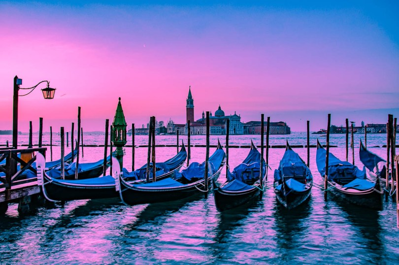 Venetian gondolas and the island of San Giorgio Maggiore under a purple dawn - Venice, Italy - rossiwrites.com
