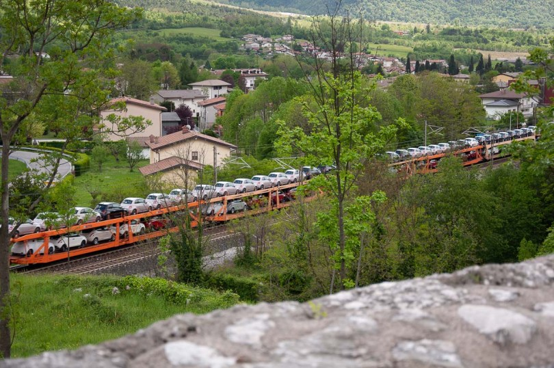 A freight train loaded with new cars - Venzone, Italy - rossiwrites.com