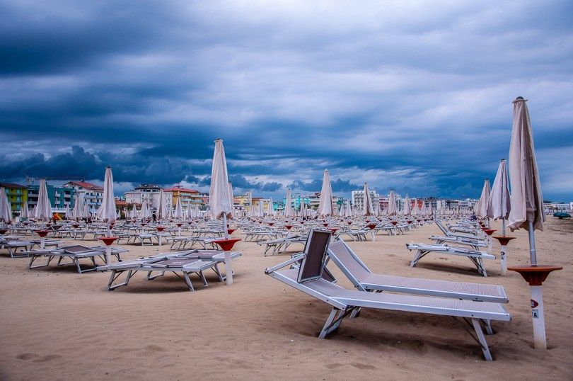 A huge sandy beach lined up by colourful hotels - Caorle, Italy - rossiwrites.com