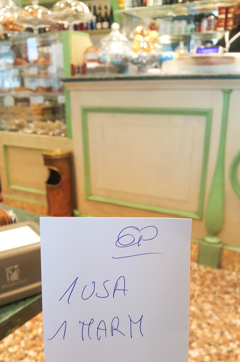 Handwritten receipt to give to the cashier in an Italian bar - Vicenza, Italy - rossiwrites.com