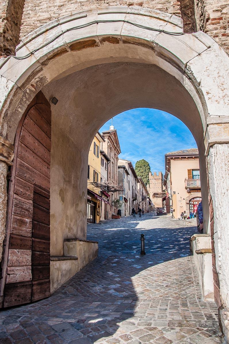 The fortified village glimpsed through Porta Firau - Gradara, Italy - rossiwrites.com