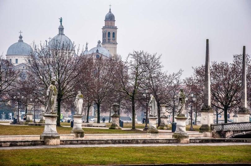 Prato della Valle and the Basilica of Santa Giustina on a foggy morning - Padua, Italy - rossiwrites.com