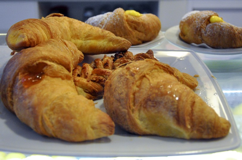 A plate with different types of brioche and breakfast pastries - Treviso, Italy - rossiwrites.com
