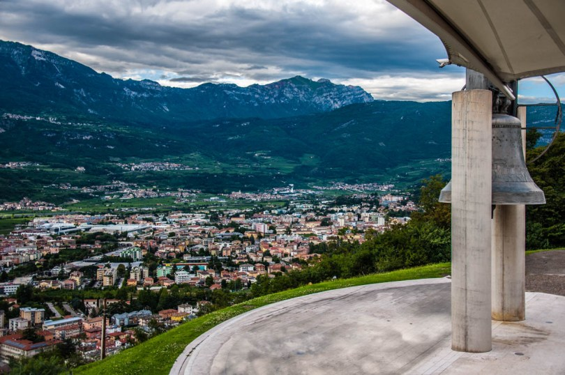 The Bell of the Fallen against a panoramic view of the city of Rovereto - Trentino, Italy - rossiwrites.com