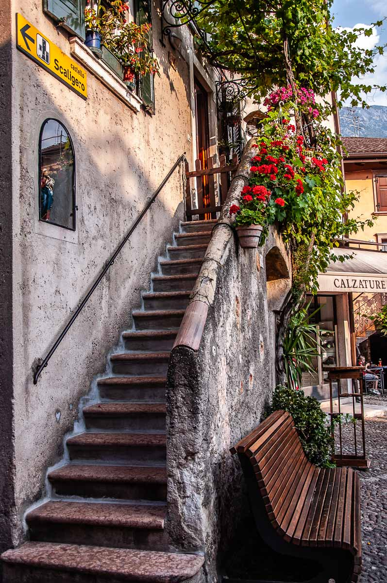 Steps leading to the door of an old house in the historic centre - Malcesine, Italy - rossiwrites.com