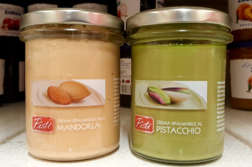 Jars with an almond spread and a pistacchio spread in a local supermarket - Vicenza, Italy - rossiwrites.com