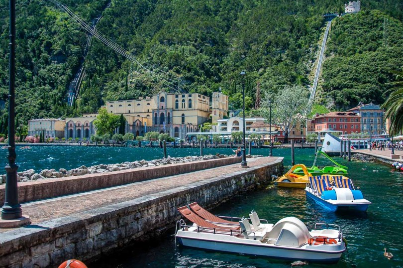 The harbour with pedalos and the Hydroelectric station - Riva del Garda, Italy - rossiwrites.com
