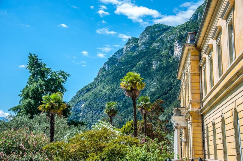 Yellow house surrounded by lush vegetation - Riva del Garda, Italy - rossiwrites.com