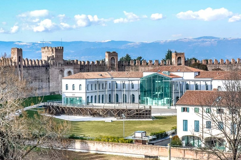 The Andrea Mantegna Town Hall with the defensive wall and snow-capped mountains behind it - Cittadella, Italy - rossiwrites.com