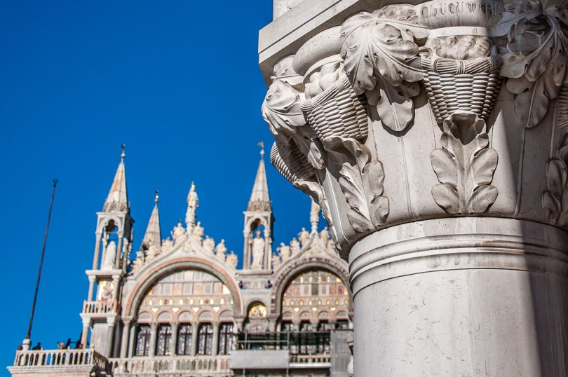 The facade of St. Mark's Basilica and a close-up of a capital of the Doge's Palace - Venice, Italy - rossiwrites.com