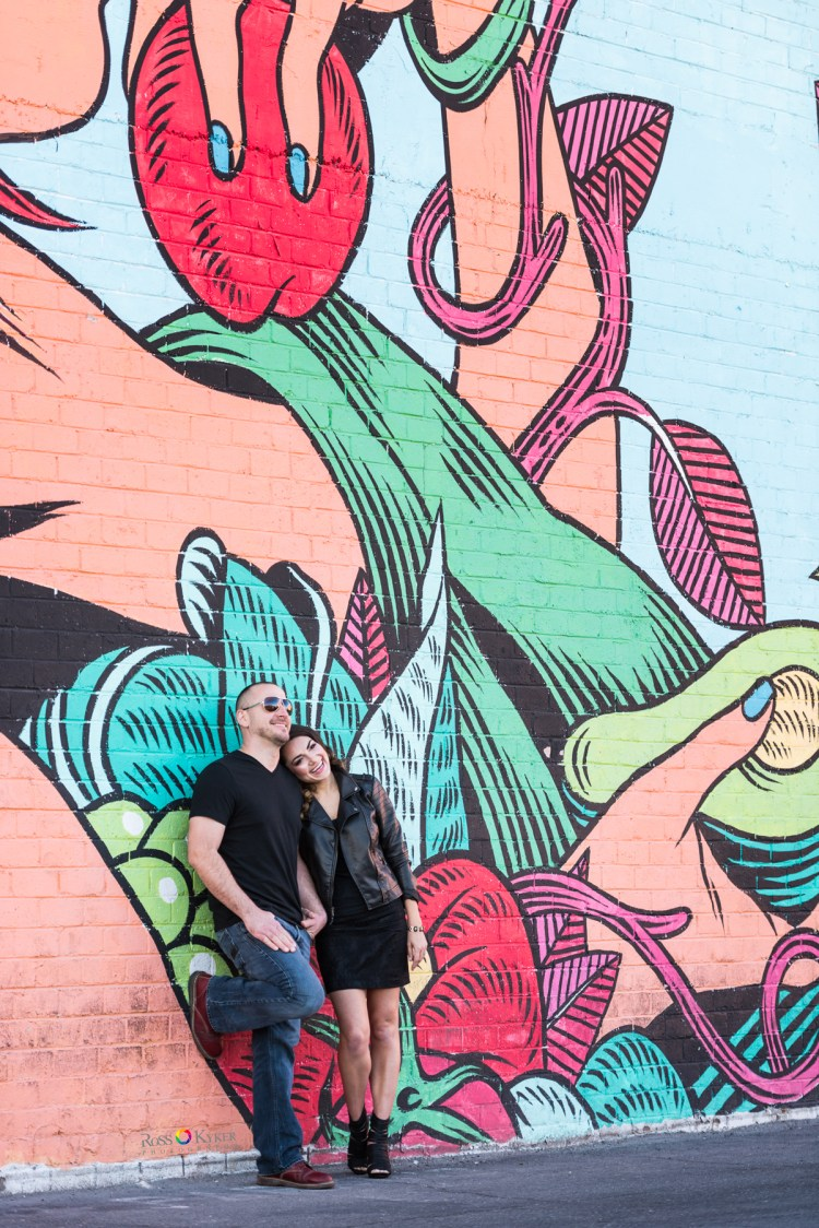 Las Vegas engagement photo in front of graffiti wall