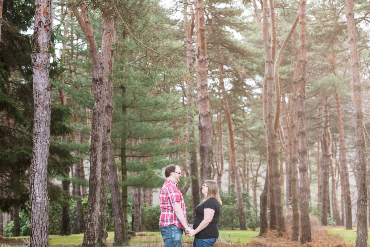 couple holding hands forest engagement photos