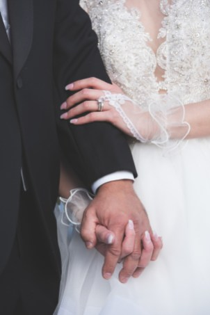 close up husband and wife holding hands