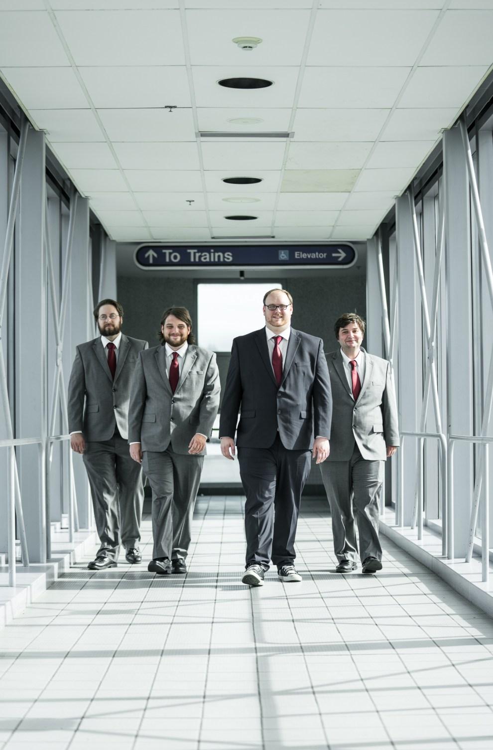groomsmen at train station