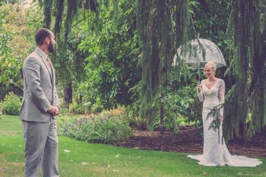first wedding look bride and groom in woods