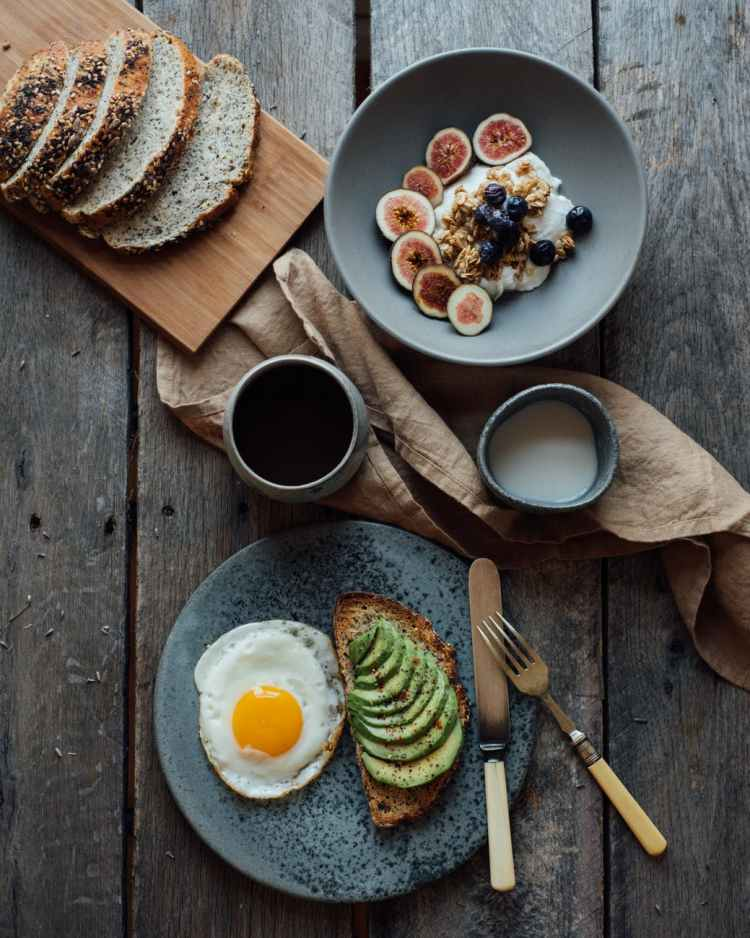served healthy breakfast on wooden table
