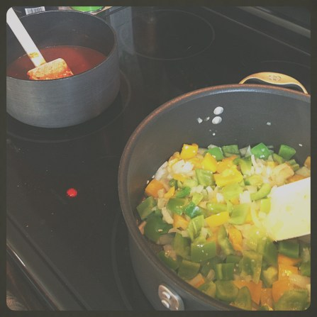 Cooking up onions and peppers.