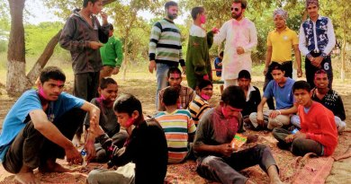 DRR Yatin Sehgal (in white kurta) playing Holi with children in a home in Rajpura.