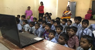 Schoolchildren watching a film that highlights awareness on child abuse.