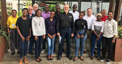 RI President Barry Rassin (centre) with Rotaractors in Mozambique.