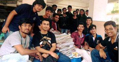 Rotaractors with a collection of old newspapers to raise funds for helping orphanages.