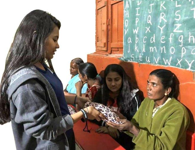 A rural woman gets a sanitation kit.