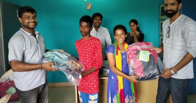 DRR (2019-20) Vinod Kumar Ameti (left) giving schoolbags to inmates of Desire Society.