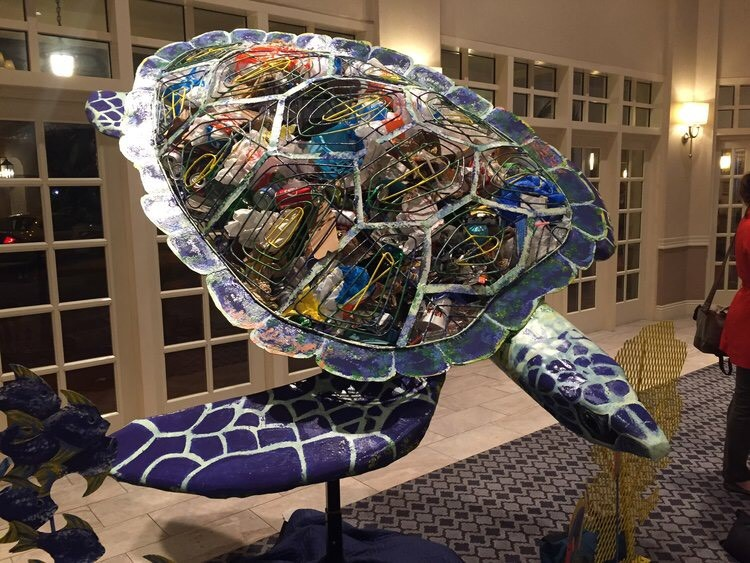 """According to Andrea O'Rourke, Club member and a member of the Boca Raton City Council, """"Boca is working on being a leader in building a sustainable environment. This metal sea turtle sculpture filled with plastic waste will become a symbol supporting the environment and public art as a collaborative Youth community project."""" These energetic youth have already received buy-in and endorsements to continue to move forward from various departments and advisory boards within the City of Boca Raton. Three of the students who presented go to Boca Raton Community High School and the fourth attends Florida Atlantic University. The project is a collaborative effort between students across all schools including Boca High, FAU and Spanish River High School.3"""