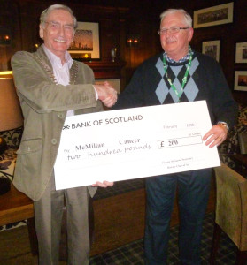 "Dennis Clifford from McMillan Cancer receiving a ""Treasure Chest"" cheque for £200"