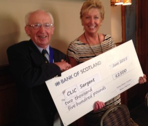 President Neil Beattie presenting a cheque for £2500 to May Gilchrist of CLIC Sargent