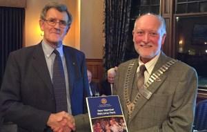 President Douglas welcoming Ieuan Isaac into Rotary