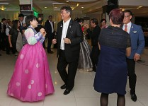 Past District Governor Ramon Cua Locsin dancing with a Korean guest in traditional costume.