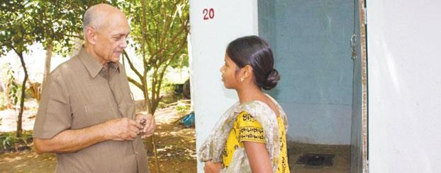 PRIP Kalyan Banerjee interacting with a resident at Amarampedu.