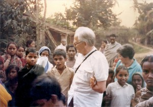 Dr Peter Berghaus with the beneficiaries in a village - 1978.