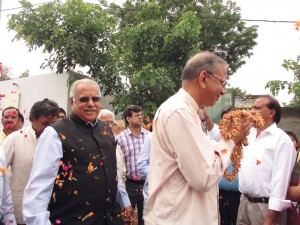 RI President K R Ravindran and RID Manoj Desai being welcomed at the Gejha village school.