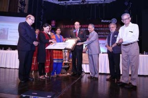 RID P T Prabhakar and PRIP Rajendra K Saboo present the award to Preethi Iyer and Mughda Dandekar of Prerana. Also in the picture PRIDs Ashok Mahajan and Sudarshan Agarwal and DG Sanjay Khanna.