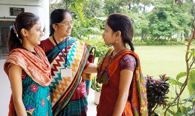 Principal Hemali Desai with commerce students, Dimple Prajapati and Khusbu Sharma.