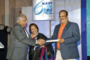 Marlene Kamdar handing over a DD of $25,000 for TRF to RI Director Manoj Desai. Also present DG D 3230, C R Raju.